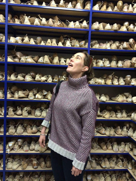 Melinda Hughes admiring a wall full of lasts at John Lobb's Paris atelier