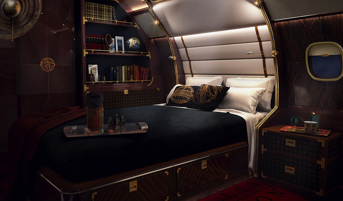 The master suite is intimate and sensuous with a queen-size bed lined in padded suede, and fitted with reading lights that adjust up and down the ship's trusses, while a flat screen TV faces opposite. Image Credit: www.embraerexecutivejets.com