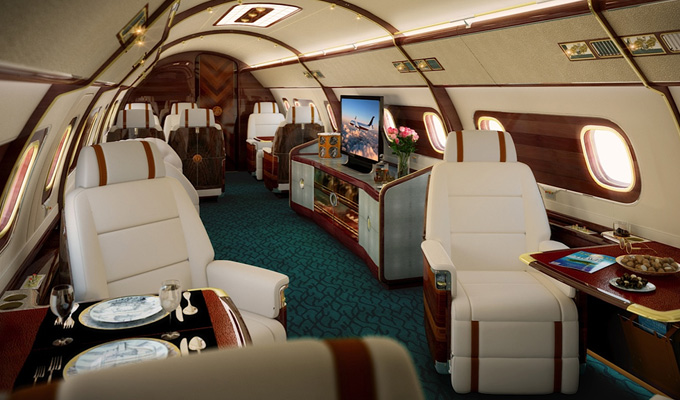 "The Skyatch one has five cabin zones with a TV, cocktail bar and lavish seating with enchased panelling and window ""portholes"" lined in brass, nickel and mahogany. Image Credit: www.embraerexecutivejets.com"